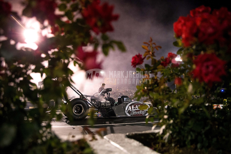 May 30, 2014; Englishtown, NJ, USA; The car of NHRA top fuel driver Shawn Langdon is visible through flowers during qualifying for the Summernationals at Raceway Park. Mandatory Credit: Mark J. Rebilas-