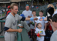 Right fielder Kyle Parker (8) of the Asheville Tourists signs an autograph before a game against the Greenville Drive on May 1, 2011, at Fluor Field at the West End in Greenville, S.C. A former quarterback and outfielder for the Clemson Tigers, Parker was the No. 1 pick of the Colorado Rockies in the 2010 First-Year Player Draft. Photo by Tom Priddy / Four Seam Images