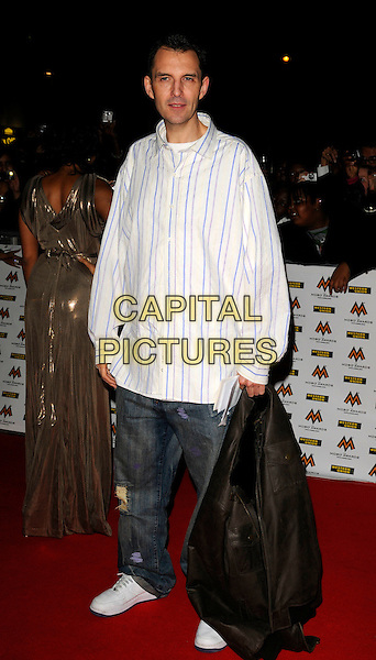 TIM WESTWOOD.MOBO Awards at Wembley Arena, London, England. .October 15th, 2008 .MOBOS music of black origin full length white striped stripes shirt jeans denim carrying leather jacket .CAP/CAN.©Can Nguyen/Capital Pictures.