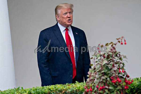 United States President Donald J. Trump speaks to members of the media while standing in the Colonnade of the White House after a Rolling to Remember ceremony honoring the nation's veterans and prisoners of war/missing in action (POW/MIA) in Washington, D.C., U.S., on Friday, May 22, 2020. Trump didn't wear a face mask during most of his tour of Ford Motor Co.'s ventilator facility Thursday, defying the automaker's policies and seeking to portray an image of normalcy even as American coronavirus deaths approach 100,000. <br /> Credit: Andrew Harrer / Pool via CNP/AdMedia