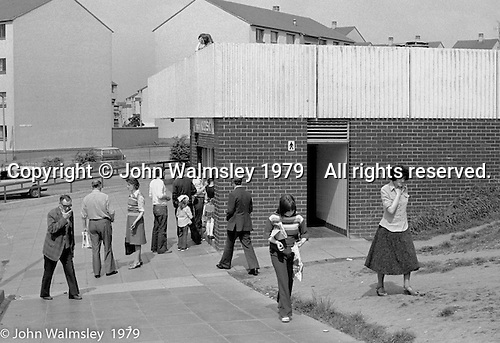 Corner kiosk and public toilet, Wester Hailes, Scotland, 1979.  John Walmsley was Photographer in Residence at the Education Centre for three weeks in 1979.  The Education Centre was, at the time, Scotland's largest purpose built community High School open all day every day for all ages from primary to adults.  The town of Wester Hailes, a few miles to the south west of Edinburgh, was built in the early 1970s mostly of blocks of flats and high rises.