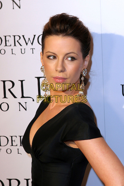 "KATE BECKINSALE.World Premiere of ""Underworld Evolution"" held at the Cinerama Dome, Hollywood, California..January 11th, 2006.Photo: Zach Lipp/AdMedia/Capital Pictures.Ref: ZL/ADM.headshot portrait dangling gold diamond earrings.www.capitalpictures.com.sales@capitalpictures.com.© Capital Pictures."