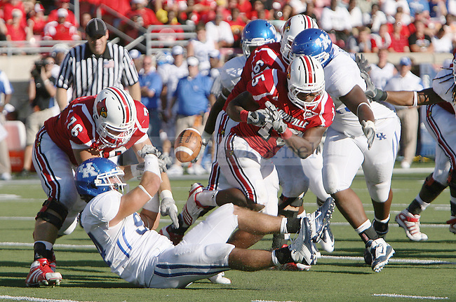 UK's Taylor Wyndham forces a fumble from Louisville's Bilal Powell at Papa John's Cardinal Stadium on Saturday, Sept. 4, 2010. Photo by Scott Hannigan | Staff