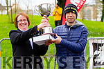 Elma Walsh presents the trophy to Gary O'Hanlon winner of the Kerry's Eye Tralee, Tralee International Marathon on Saturday.