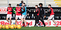 Fleetwood Town's sports scientist Youl Mawene leads the pre-match warm-up<br /> <br /> Photographer Chris Vaughan/CameraSport<br /> <br /> The EFL Sky Bet League One - Saturday 23rd February 2019 - Burton Albion v Fleetwood Town - Pirelli Stadium - Burton upon Trent<br /> <br /> World Copyright © 2019 CameraSport. All rights reserved. 43 Linden Ave. Countesthorpe. Leicester. England. LE8 5PG - Tel: +44 (0) 116 277 4147 - admin@camerasport.com - www.camerasport.com