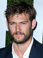 BEVERLY HILLS, CA, USA - OCTOBER 02: Alex Pettyfer arrives at Michael Kors Launch Of Claiborne Swanson Franks's 'Young Hollywood' Book held at a Private Residence on October 2, 2014 in Beverly Hills, California, United States. (Photo by Xavier Collin/Celebrity Monitor)