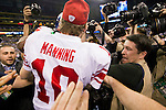 Photographers swarm New York Giants quarterback Eli Manning (10) after the Giants won the NFL Super Bowl XLVI football game against the New England Patriots on Sunday, Feb. 5, 2012, in Indianapolis. The Giants won 21-17 (AP Photo/David Stluka)...