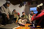 Rangers Temirlan Baktygul, Urmat Solokov, Anne-lise Cabanat, Michel Gierst, Temirbek Jandrbaev listening to Ulan Abulgaziev playing the ukulele, Sarychat-Ertash Strict Nature Reserve, Tien Shan Mountains, eastern Kyrgyzstan relaxing in camp during evening, Sarychat-Ertash Strict Nature Reserve, Tien Shan Mountains, eastern Kyrgyzstan