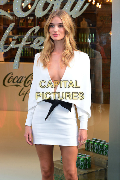 LONDON, ENGLAND - SEPTEMBER 19: Rosie Huntington-Whitely attends a photocall to launch Coca Cola Life on September 19, 2014 in London, England. <br /> CAP/JOR<br /> &copy;Nils Jorgensen/Capital Pictures