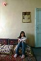 Turkey 2015<br />Ruveyda, young Kurdish girl in the sitting room at home in Dogubayazit  <br />Turquie 2015  Ruveyda, jeune-fille kurde, assise dans le salon de la maison familiale a Dogubayazit
