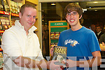 Cheers: First to get the latest and last book in the Harry Potter series, Harry Potter and the Deathly Hallows, in Easons at midnight on the dot on Friday night was Daniel Finnegan, Mitchels Ave., receiving his free copy from John Levins, Manager, Easons Tralee..