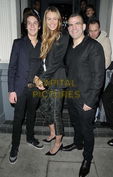 Elle Macpherson with her son ( left ) & Barry.attended the Barry the Dog VIP fundraiser, No. 3 bar & nightclub, Cromwell Rd., London, England..March 26th, 2013.full length black blazer pattern cropped trousers mother mom mum family blue shirt suit white side.CAP/CAN.©Can Nguyen/Capital Pictures.