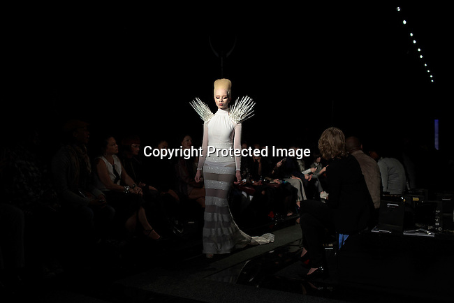 JOHANNESBURG, SOUTH AFRICA APRIL 13: An albino model walks for the designer Gert-Johan Coetzee during a fashion show at South Africa Fashion Week on April 13, 2013 held in Johannesburg, South Africa. Designers showed their spring/summer collections. (Photo by: Per-Anders Pettersson)