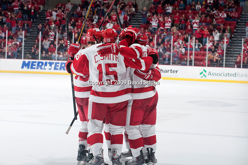 The Wisconsin Badgers celebrate a goal during an NCAA hockey game against the Minnesota Golden Gophers at the Kohl Center on 11/7/2009 in Madison, Wisconsin. The Golden Gophers won 5-2. (Photo by David Stluka)