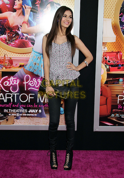 "Victoria Justice.""Katy Perry: Part Of Me"" Los Angeles Premiere held at Grauman's Chinese Theatre, Hollywood, California, USA..June 26th, 2012.full length grey gray black clutch bag peep toe boots jeans denim print top hand on hip.CAP/ADM/RE.©Russ Elliot/AdMedia/Capital Pictures."