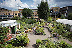 © Joel Goodman - 07973 332324 . 27 July 2013 . Hulme Community Garden Centre , Old Birley Street , Hulme , Manchester M15 , UK . A GV of the garden centre as viewed from the roof garden . Hulme is Where the Art Is festival . Photo credit : Joel Goodman