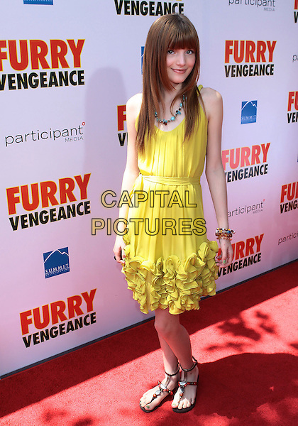 "BELLA THORNE .Los Angeles Premiere Of Summit Entertainment's ""Furry Vengeance"" held at The Mann Bruin Theatre, Westwood, California, USA, 18th April 2010..full length sleeveless yellow dress ruffles ruffle sandals .CAP/ADM/TC.©T. Conrad/AdMedia/Capital Pictures."