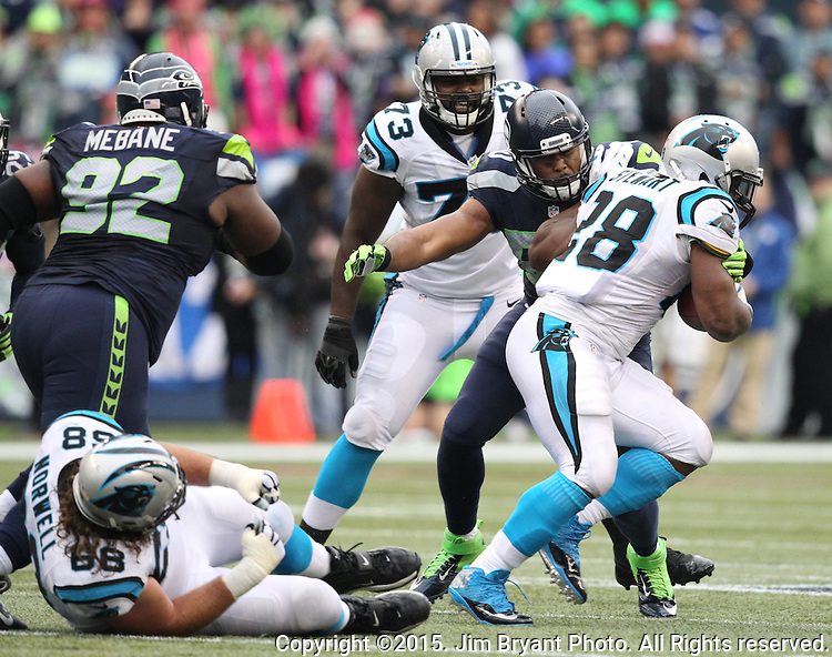 Seattle Seahawks K.J. Wright, (50),  tackles Carolina Panthers  running back Jonathan Stewart (28) at CenturyLink Field in Seattle on October 18, 2015. The Panthers came from behind with 32 seconds remaining in the 4th Quarter to beat the Seahawks 27-23.  ©2015 Jim Bryant Photography. All Rights Reserved.