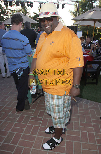 CEDRIC THE ENTERTAINER .Launch Of The Ann & George Lopez Foundation At The Third Annual George Lopez Celebrity Golf Classic_ Cocktail Dinner held At The Lakeside Country Club, Toluca Lake, California, USA..May 3rd, 2010.full length yellow polo shirt green plaid tartan shorts sunglass shades .CAP/ADM/KB.©Kevan Brooks/AdMedia/Capital Pictures.