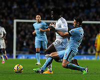 Picture: Andrew Roe/AHPIX LTD, Football, Barclays Premier League, Manchester City v Swansea City, 22/11/14, Etihad Stadium, K.O 3pm<br /> <br /> City's Martin Demichelis slides in on Swansea's Wilfried Bony<br /> <br /> Andrew Roe>>>>>>>07826527594