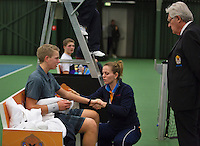 Rotterdam, The Netherlands, 07.03.2014. NOJK ,National Indoor Juniors Championships of 2014, 12and 16 years, Tom Moonenn (NED) is treated by a fysio after falling<br /> Photo:Tennisimages/Henk Koster