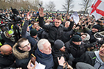 "© Joel Goodman - 07973 332324. 18/03/2018 . London , UK . TOMMY ROBINSON (centre) delivers the speech to the crowd . 1000s including supporters of alt-right groups such as Generation Identity and the Football Lads Alliance , at Speakers' Corner in Hyde Park where Tommy Robinson reads a speech by Generation Identity campaigner Martin Sellner . Along with Brittany Pettibone , Sellner was due to deliver the speech last week but the pair were arrested and detained by police when they arrived in the UK , forcing them to cancel an appearance at a UKIP "" Young Independence "" youth event , which in turn was reportedly cancelled amid security concerns . Photo credit : Joel Goodman"