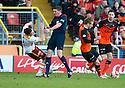 Motherwell's Simon Ramsden collides with Referee Craig Thomson.