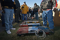 An auctioneer solicits bids for emergency vehicle light bars from people gathered at a police seized goods auction in Blendon Township, Ohio<br />