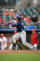 Charlotte Stone Crabs left fielder David Olmedo-Barrera (15) follows through on a swing during a game against the Palm Beach Cardinals on July 22, 2017 at Roger Dean Stadium in Palm Beach, Florida.  Charlotte defeated Palm Beach 5-2.  (Mike Janes/Four Seam Images)