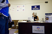 Obama Campaign Volunteer Beth Silberman speaks with field organizer A.J. Donaldson inside the Main St. campaign office in Durham, NC.