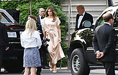 First Lady Melania Trump  and United States President Donald J. Trump (R) exit the residence to attend a reception at the Fordís Theatre , on June 4, 2017 in Washington, DC. <br /> Credit: Olivier Douliery / Pool via CNP