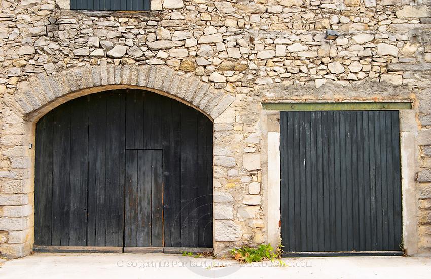 Chateau de Lascaux, Vacquieres village. Pic St Loup. Languedoc. A door. The winery building. France. Europe.