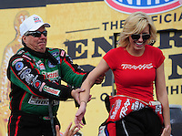 Feb. 19, 2012; Chandler, AZ, USA; NHRA funny car driver John Force (left) jokes with daughter Courtney Force during the Arizona Nationals at Firebird International Raceway. Mandatory Credit: Mark J. Rebilas-