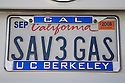 A close up of a 'SAV3 GAS' (Save Gas) license plate with a UC Berkeley frame. The plate is on a Toyota Prius. Mountain View, California, USA
