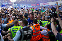 Cardiff captain Sean Morrison makes it to the tunnel after battling through fans celebrating on the pitch after the Sky Bet Championship match between Cardiff City and Reading at the Cardiff City Stadium, Cardiff, Wales on 6 May 2018. Photo by Mark  Hawkins / PRiME Media Images.