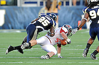 27 November 2010:  FIU cornerback Jonathan Cyprien (25) prevents Arkansas State tight end Jeff Blake (42) from holding on to a pass in the second quarter as the FIU Golden Panthers defeated the Arkansas State Red Wolves, 31-24, at FIU Stadium in Miami, Florida.