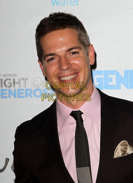 Jason Kennedy<br /> Generosity Water's 5th Annual Night Of Generosity Benefit Held at the Beverly Hills Hotel, Beverly Hills, California, USA, <br /> 6th September 2013.<br /> portrait headshot brown suit tie pink shirt <br /> CAP/ADM/KB<br /> &copy;Kevan Brooks/AdMedia/Capital Pictures