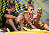 Waimea Bay, North Shore of Oahu, Hawaii.  December 4 2014) Peter Mel (USA) and Jamie Mitchell (AUS). - The Opening Ceremony of the 2014 Quiksilver In Memory of Eddie Aikau contest was held this afternoon in the park at Waimea Bay. This winter, the big wave riding event celebrates a special milestone of 30 years. <br /> The Quiksilver In Memory of Eddie Aikau is a one-day big wave riding event that only takes place if and when waves meet a 20-foot minimum height, during the holding period of December 1 through February 28, each Hawaiian winter. The official Opening Ceremony with the Aikau Family will be held on Thursday, December 4th, 3pm, at Waimea Bay.<br />  <br /> &quot;The Eddie&quot; is the original big wave riding event and stands as the measure for every big wave event that exists in the world today. It has become an icon of surfing through its honor, integrity and rarity.<br />  <br /> The event honors Hawaiian hero Eddie Aikau, whose legacy is the respect he held for the ocean; his concern for the safety of all who entered it on his watch; and the way with which he rode Waimea Bay on its most giant and memorable days. <br />  <br /> Adherence to strict wave height standards has ensured its integrity; it is only held on days when waves meet or exceed the Hawaiian 20-foot minimum (wave face heights of approximately 40 feet). This was the threshold at which Eddie enjoyed to ride the Bay. It has been said that what makes The Eddie special is the times it doesn't run, because that is precisely its guarantee of integrity and quality days of giant surf.<br />  <br /> The competition has only been held a total of 8 times: it's inaugural year at Sunset Beach, and then seven more times at its permanent home of Waimea Bay. The Eddie was last held on December 9, 2009, won by California's Greg Long.   Photo: joliphotos.com