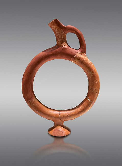 Hittite terra cotta ring shaped vessel - 16th century BC - Hattusa ( Bogazkoy ) - Museum of Anatolian Civilisations, Ankara, Turkey . Against gray background