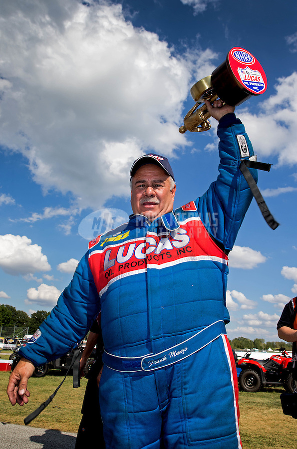 Sept. 2, 2013; Clermont, IN, USA: NHRA top alcohol funny car driver Frank Manzo celebrates after winning the US Nationals at Lucas Oil Raceway. Mandatory Credit: Mark J. Rebilas-