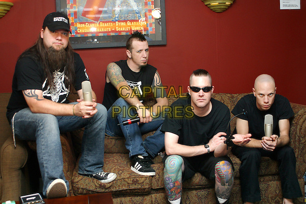 MUDVAYNE.Shure endorsement photo shoot backstage at Ozzfest- held at Starwood Amphitheatre, Nashville, Tennessee. .August  31st, 2005.Photo Credit RR/ADM.sunglasses shades band music tattoos sitting jeans denim.www.capitalpictures.com.sales@capitalpictures.com.© Capital Pictures.
