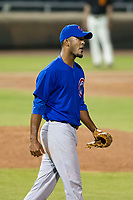 AZL Cubs relief pitcher Ivan Medina (39) begins to celebrate after the final out of Game Three of the Arizona League Championship Series against the AZL Giants on September 7, 2017 at Scottsdale Stadium in Scottsdale, Arizona. AZL Cubs defeated the AZL Giants 13-3 to win the series two games to one. (Zachary Lucy/Four Seam Images)