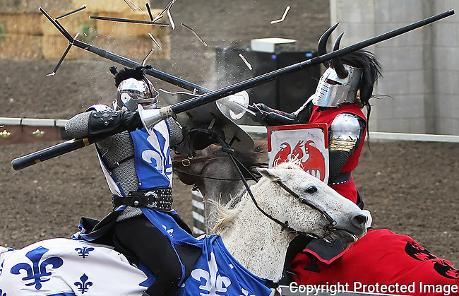 Splinters fly as the French knight and the English knight clash in a jousting exhibition at the Ellensburg Rodeo Arena during Ye Olde Country Faire, Saturday, June 1, 2013. (Brian Myrick / Daily Record)
