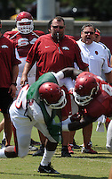 NWA Democrat-Gazette/ANDY SHUPE<br /> Arkansas coach Bret Bielema (left) and offensive line coach Sam Pittman watch Thursday, Aug. 13, 2015, as defensive and offensive players spar during practice at the university practice field in Fayetteville.