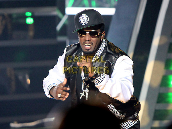 Diddy (Sean Combs).The 2012 BET Hip Hop Awards were held in Atlanta, where top hip hop artists including T.I., Busta Rhymes, Rick Ross and more performed between various awards that were handed out, Atlanta, GA, USA, September 29th, 2012..show half length live on stage concert gig cap hat sunglasses rapping singing microphone black white jacket hand p.diddy p puff daddy puffy .CAP/ADM/DH.©Dan Harr/AdMedia/Capital Pictures.