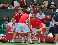 Switserland, Gen&egrave;ve, September 19, 2015, Tennis,   Davis Cup, Switserland-Netherlands, Doubles: Swiss team Marco Chiudinelli/Roger Federer (R) in the middle captain Severin Luthi<br /> Photo: Tennisimages/Henk Koster