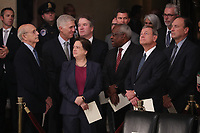Justices of the U.S. Supreme Court including (L-R) Associate Justices Stephen Breyer, Neil Gorsuch, Elena Kagan, Brett Kavanaugh, Clarence Thomas, Chief Justice John Roberts and Associate Justice Samuel Alito await the arrival of the casket of former U.S. President George H.W. Bush inside the U.S. Capitol Rotunda, where it will lie in state in Washington, U.S., December 3, 2018. <br /> CAP/MPI/RS<br /> &copy;RS/MPI/Capital Pictures
