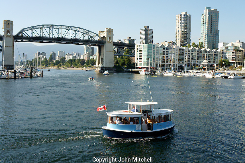 Water taxi crossing False Creek from Granville Island, Vancouver, BC, Canada