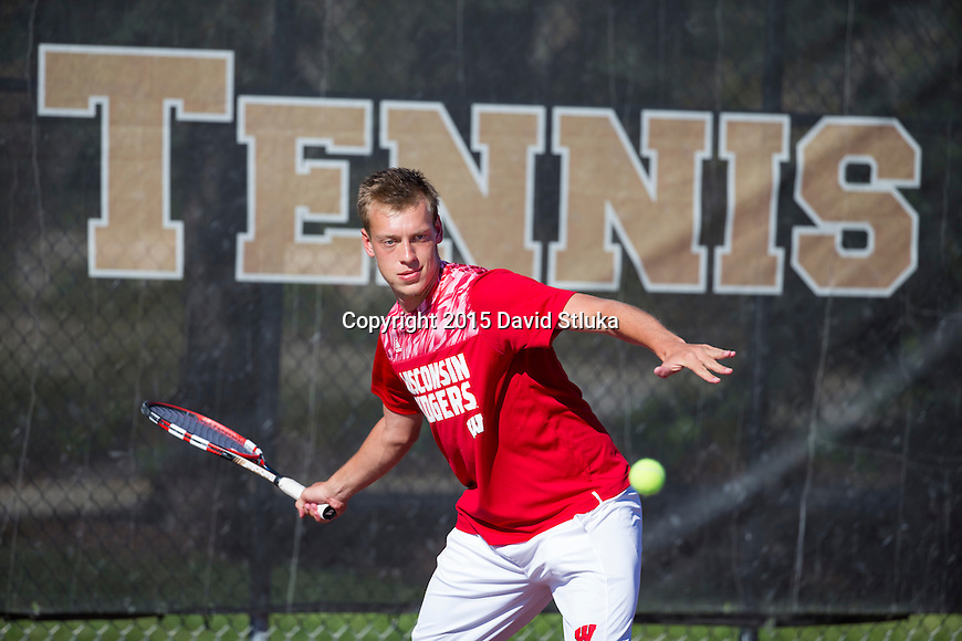 Simulated action photo of Wisconsin Badgers tennis player Alexander Kokorev on Monday, September 21, 2015, in Madison, Wis. (Photo by David Stluka)