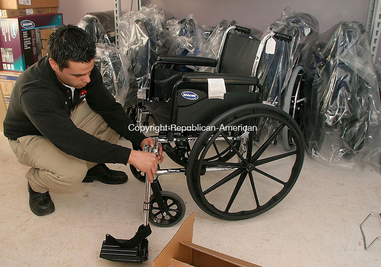 WATERBURY, CT-01 February 2005-020105TK15  Joe Loyer, Service Technician for J&L Medical Services, prepares to assemble a wheelchair for a customer.  Tom Kabelka staff photo ( J&L Medical Services, Joe Loyer )CQ